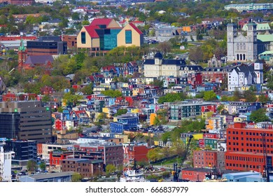 ST. JOHN'S, NEWFOUNDLAND AND LABRADOR - JUNE 14, 2017: A view of the colorful buildings of St. John's, Newfoundland, on a sunny day.