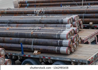 St. John's, Newfoundland/Canada - April 2019: Drilling risers, a vertical pipe used in offshore oil operations sits on a platform.The drill stack of drill pipe are used for drilling mud in oil and gas