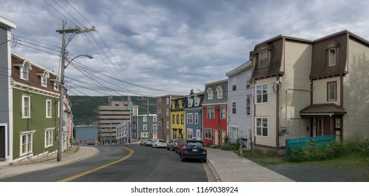 ST. JOHN'S, NEWFOUNDLAND/CANADA - JULY 23, 2018: Row of colorful houses in historic downtown of St. John's in Newfoundland and Labrador