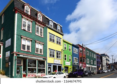 St. John's, NL, Canada - August 12, 2018:  A row of colourful shops on Duckworth Street. St. John's is the oldest city in North America, and many of the buildings are appreciated for their history.