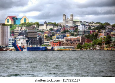 St. John's, NL, Canada - August 10, 2018:  Downtown St. John's featuring the Basilica of St. John the Baptist and the colorful row houses the city is known for.