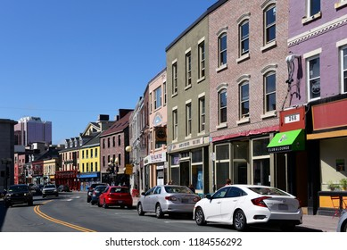 St. John's, NL, Canada - August 12, 2018:  A row of colorful shops on Water Street. St. John's is the oldest city in North America, and many of the buildings are appreciated for their history.