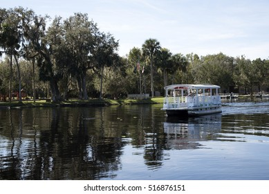 St Johns River in Volusia County Florida USA - October 2016 - A battery powered boat used to ferry passengers to Hontoon Island state park  underway on the St Johns River close to DeLand Fl