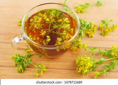 St. John's wort and herbal tea isolated on wooden background