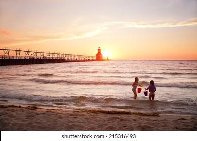 St Joseph Lighthouse on Lake Michigan at sunset