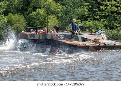 St Joseph MI USA June 22, 2019; a military amphibious vehicle transports civilians on the St Joseph river, during the Lest we forget event.