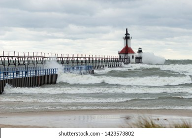 St. Joseph Michigan Lighthouse on  Nov. 19, 2016, a windy and stormy day with crashing waves onto the pier and  lighthouse. Shot from Tiscornia Park beach.