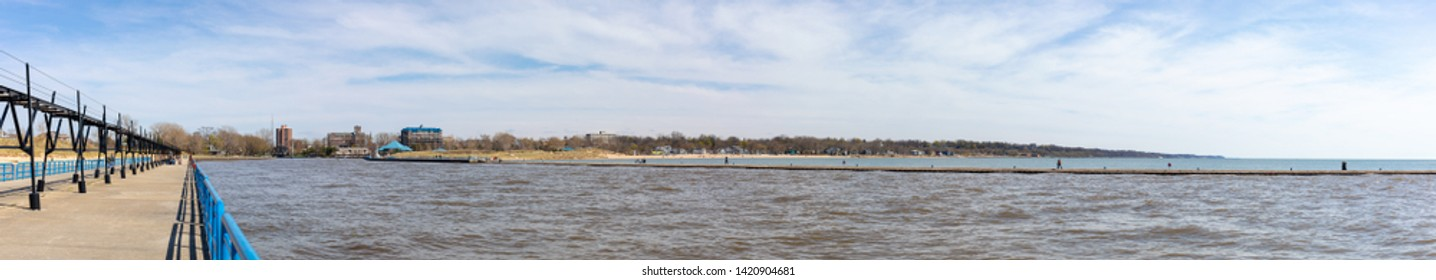 St. Joseph, Michigan, USA - May 4, 2019: View of the piers protecting the harbor entrance into the St Joseph River