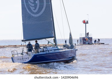 St. Joseph, Michigan, USA - May 4, 2019: Sail Boat leaving the harbor from St Joseph River and entering the Michigan Lake
