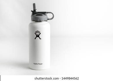 St. Joseph, Missouri / United States of America- July 13th 2019 : Hydro Flask insulated water bottle with sipper lid.  In white on white to gray background.