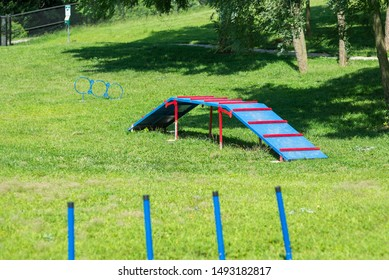 St. Joseph, Missouri / United States of America - August 30th, 2019 : Dog agility equipment in the small dog section of Corby Dog Park.