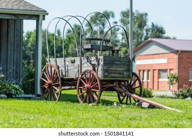 St. Joseph, Missouri / United States of America - August 29th, 2019 : An antique wooden wagon on display outside of the Pony Express museum in St. Joseph.