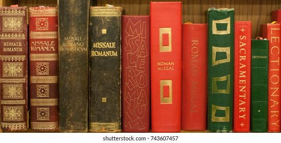 ST. JOSEPH, MN - October 28, 2017: Series of Catholic Roman Missals lined up on a bookshelf