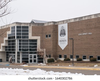 St. Joseph, MO / United States of America - January 31st, 2020 : Leah Spratt hall with Walter Cronkite Memorial banner hanging on the side of the building.  Main entrance with driveway in winter.