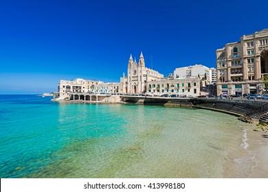 ST JULIANS, MALTA - APRIL 13, 2014: Our Lady of Mount Carmel Church on Balluta Bay in St. Julian's, Malta on April 13, 2014.