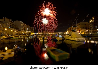 ST JULIANS, MALTA - CIRCA AUGUST 2011: Traditional fireworks display over Spinola Bay in St Julians