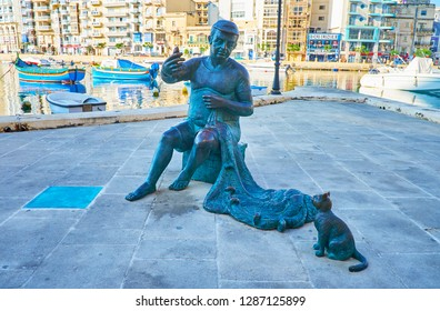 ST JULIANS, MALTA - JUNE 20, 2018: The bronze statue of old fisherman, going to feed the cat with a small fish at Spinola Bay harbor, on June 20 in St Julians.