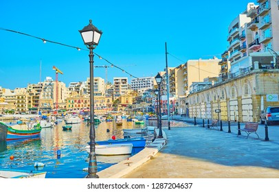 ST JULIANS, MALTA - JUNE 20, 2018: Coastal quarters of St Julian's are quiet and calm place in the early morning, it's pleasure to walk here and enjoy atmosphere of resort, on June 20 in St Julians.