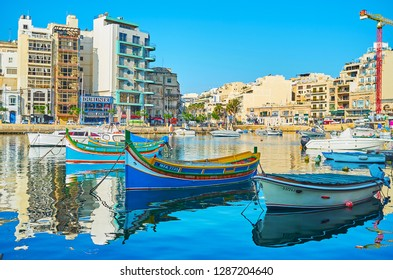 ST JULIANS, MALTA - JUNE 20, 2018: Resort boats many nice places for rest, Spinola Bay is nice location to visit coastal cafe, walk along the harbor and watch the luzzu boats, on June 20 in St Julians