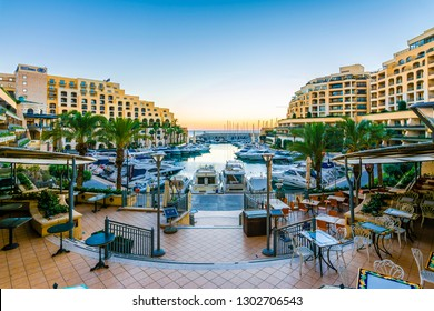 St. Julians, Malta - November 11, 2015: Yachts in the Portomaso Marina view in St Julians, Malta. Marina is surrounded with luxury apartments.