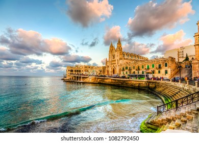 St Julians, Malta - November 12, 2015: Our Lady of Mount Carmel Church view on Balluta Bay in St. Julian's,