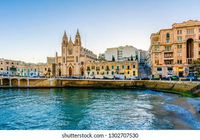 St. Julians, Malta - November 14, 2015 : Our Lady of Mount Carmel Church on Balluta Bay in St. Julian's, Malta. St Julians is populer tourist destination in Malta.