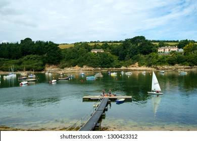 St Just in Roseland, UK - 25th July 2017: A calm summer morning brings people out to their small boats on the creek at St Just in Roseland on the picturesque Roseland Peninsula in Cornwall, UK