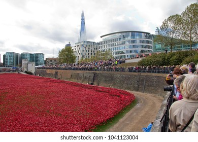 ST KATHERINES & WAPPING, LONDON, UK – NOVEMBER 7, 2014: The Blood Swept Lands and Sea of Red display, commemorating the 888,246 British and Commonwealth lives lost in WW1, at the Tower of London.