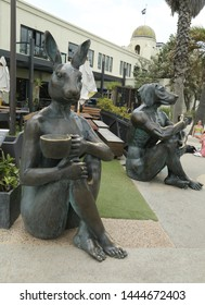 ST KILDA, AUSTRALIA - JANUARY 25, 2019: The coffee drinkers statues by Gillie and Mark in St. Kilda Beach, Melbourne