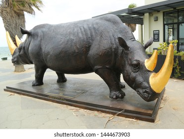 "ST KILDA, AUSTRALIA - JANUARY 25, 2019: ""The Wonderful Two""statue by Gillie and Mark in St. Kilda Beach, Melbourne. It is the largest rhino sculpture in Australia"
