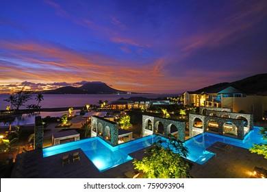 ST KITTS, ST KITTS AND NEVIS -19 NOV 2017- Dramatic orange sunrise over the Park Hyatt St Kitts, a luxury upscale hotel resort in Christopher Harbor, Saint Kitts. The hotel opened in November 2017.