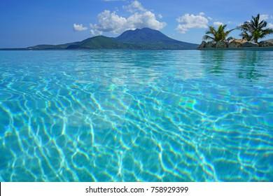 ST KITTS, SAINT KITTS AND NEVIS -19 NOV 2017- View of Nevis Island and the Nevis Peak across the water from the Park Hyatt St Kitts, a luxury resort hotel in Christopher Harbor opened in Nov 2017.