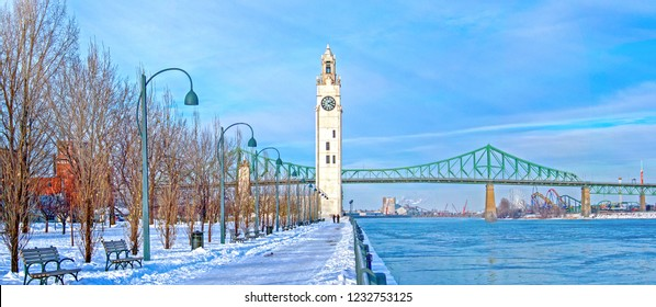 St. Lawrence River with Big Ben in Old Montreal, Quebec, Canada and Jacques-Cartier Bridge in background, winter season