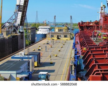 St. Lawrence Seaway, Canada - August 30, 2012: Big tankers ship oil passing through the river locks system. Sunny day landscape