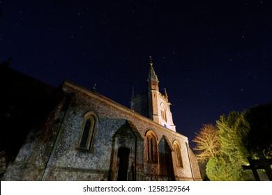 St Leonard's Church in the night sky, Oakley, Basingstoke Hampshire