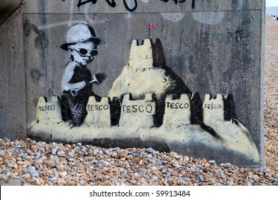 "ST. LEONARDS-ON-SEA, ENGLAND - AUGUST 28: A new mural by cult British street artist ""Banksy"" on the seafront on August 28, 2010 at St.Leonards-on-Sea, East Sussex. Banksy is a world famous artist."