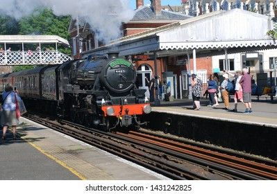 ST. LEONARDS-ON-SEA, ENGLAND - JUNE 22, 2019: London Midland and Scottish Railway Class 5 steam locomotive, 44871, hauls an excursion train. Designed by William Stanier, it was built in 1945.