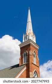 St Lorenz Lutheran Church steeple against blue sky located near Frankenmuth, Michigan.