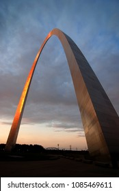 St Louis Arch landmark metal gateway sunset glowing orange