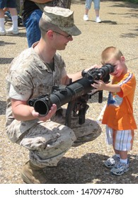 St. Louis, Missouri  - April, 14 2010: Civilians pose with US military weapons for Marine Week St. Louis.