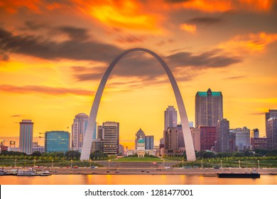 ST. LOUIS, MISSOURI - AUGUST 23, 2018: The downtown cityscape and Gateway Arch on the Mississippi River just after sunset.