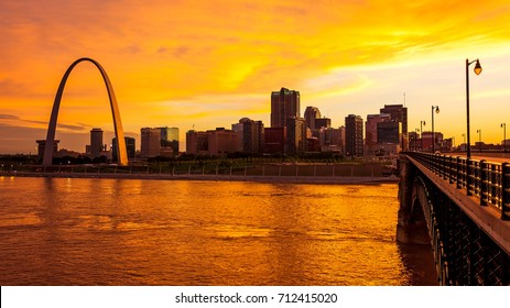 St Louis, Missouri cityscape skyline and Gateway Arch as night falls over downtown (logos removed for commercial use)