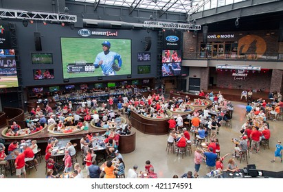 ST. LOUIS, MISSOURI - SEPTEMBER 6, 2015: People eating and watching a baseball game at a restaurant in the Busch Stadium before the home game of St.Louis Cardinals.