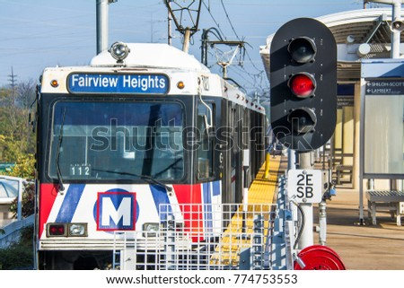 St. Louis, Missouri, United States -  circa 2016 -Metrolink transit commuter passenger train leaving shrewsberry station St Louis Missouri
