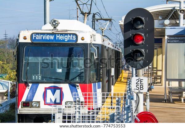 St. Louis, Missouri, United States -  circa 2016 -Metrolink transit commuter passenger train leaving shrewsberry station St Louis Missouri