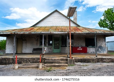 St. Louis, Missouri, USA, April 2020 - Old rural country general store out of business, in America, Coke machine on porch, groceries, food, market, branding icon, convenience, purchase, refreshments,
