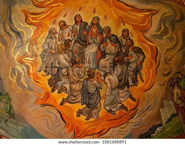 St. Louis, Missouri USA -  April 15, 2019. Close Up of the Pentecost Mosaic in the Cathedral Basilica of St. Louis with the apostles and Mary of Nazareth engulfed by the flames of the Holy Spirit.