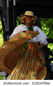 St. Louis, Missouri, USA - August 24, 2019: Festival of Nations, Tower Grove Park, Members of the Grupo Folklorico Panameno, wearing traditional clothing, performing traditional dances from Panama
