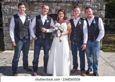 st louis, missouri, usa, august 2019 - photo of wedding party group bride groom bestman outside informal casual dress white gown and flowers