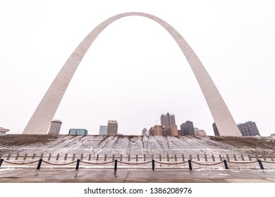 St Louis, Missouri \ USA - January 16 2019: View at Gateway Arc on a winter day from Mississippi river embankment